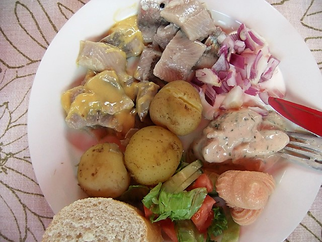 Midsummer lunch of herring and new potatoes