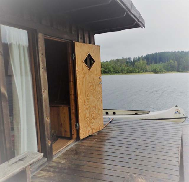 The Floating Cabin jetty with canoe moored alongside.