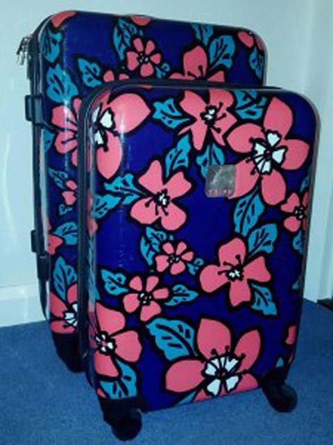 Suitcases often come in prettier colours and designs than rucksacks!