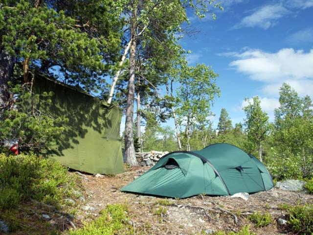 Choose a shady spot to pitch your tent.