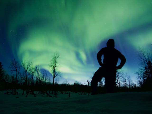 Silhouetted against the Aurora.