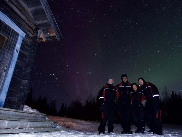 Group in front of the Northern Lights.