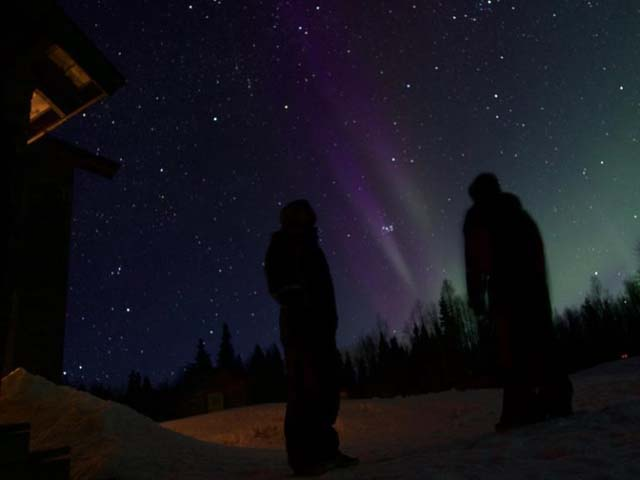 Watching the Northern Lights from the cabin.