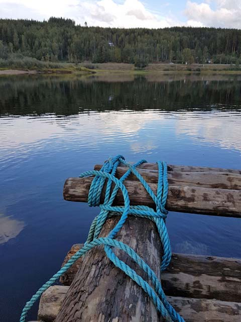 A timber raft is built using only ropes and logs.